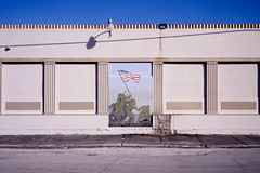 (patrickjoust) Tags: belleglade florida palmbeachcounty americanlegion iwojima mural fujicagw690 fujichromeprovia400x 6x9 medium format 120 rangefinder 90mm f35 fujinon lens manual focus analog mechanical patrick joust patrickjoust south fl usa us united states north america estados unidos autaut american flag marines monument building painting