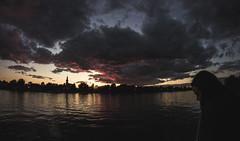 Meditative (Frdric T. Leblanc) Tags: light sunset sky people sun cinema canada water girl clouds canon river montral mtl quebec fisheye cinematic 8mm sthilaire t3i richelieu filmlook beloeil rekinon