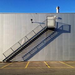 stairway to wherever (dan.boss) Tags: door shadow metal architecture stairs facade schweiz switzerland industrial suisse steel parking bluesky architektur berne corrugated mnchenbuchsee iphone4s
