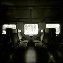 326 Ondu 12 (rubbernglue) Tags: blackandwhite bw 6x6 window analog train pinhole seats squareformat mkii norberg 2016 filmphotography ondu ilforddelta r09 filmexif bwfp