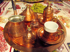 Tea Pots and Cups (shaire productions) Tags: nuts image picture photo photograph food foods egypt egyptian turkey turkish desserts sweets candy travel world tea pots cups display copper golden traditional setting culture tastes