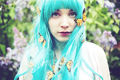 Pluie de Monarque (Andreanne Lupien) Tags: flowers plants plant flower green girl forest butterfly insect eyes teal makeup insects lila greeneyes curly wig monarch redlips concept conceptual curlyhair monarchs lilas tealhair