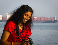 A day without laughing is a day wasted  Charles Chaplin (Neo-grapher) Tags: life red portrait people woman water photography kerala kochi southindia arabiansea fortkochi portraitphotography laughingwoman mattancherry womanwithcamera mattancheri canon18135mm canonefs18135mmf3556is