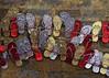 footlose (Rabbania Shirjeel) Tags: street red wall golden shoes hang chappal