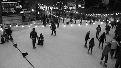 skating at dusk 02 (byronv2) Tags: street blackandwhite bw monochrome night blackwhite edinburgh dusk candid iceskating skating princesstreetgardens princesstreet icerink newtown nuit peoplewatching edimbourg edinburghbynight