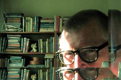 book collecting (omoo) Tags: newyorkcity sunlight self mirror apartment interior library westvillage books collection eyeglasses bookshelves greenwichvillage beveledglass mccoysailor
