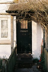 Apprentice House Cottage (zawtowers) Tags: door camera winter house snow cold tree mill film ice nikon cheshire cottage entrance property bank front national trust f80 february agfa quarry inviting apprentice overhang styal 2015 afnikkor2880mmf3356g