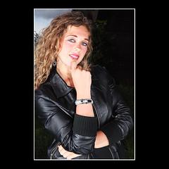 'Really?' (KoenK68) Tags: bridge portrait woman girl beautiful female hair pretty young curly bracelet redlips earrings leatherjacket koenk68