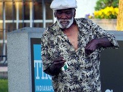 IMG_0565 (kennethkonica) Tags: life people usa man hat shirt america canon beard high midwest alone humanity random outdoor candid indianapolis indy indiana smoking mature stoned persons cigarettes moods global canonpowershot hoosier marioncounty seniorcitizen