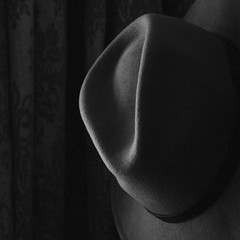 Home (No Great Hurry) Tags: light shadow blackandwhite stilllife art monochrome hat mono cool exposure flickr dof indoor depthoffield explore serene fedora curve curved amateur bnw explored robinbarr nogreathurry robinmauricebarr