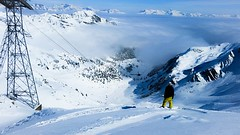 Dropping into the clouds (.craig) Tags: winter mist snow man mountains alps sports sport clouds standing snowboarding europe exercise cable powder pylon snowboard thealps activity snowboarder valais verbier snowsport cloudinversion europeanalps manstandinginsnow