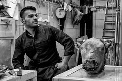 Butcher Shop (Saman A. Ali) Tags: people monochrome animal shop blackwhite head streetphotography balckandwhite butcher fujifilm kurdistan slemani fujifilmxt1