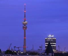 Munich - TV Tower and BMW Vierzylinder (cnmark) Tags: blue light tower night germany munich mnchen deutschland tv hour bmw fernsehturm hq headquarter vierzylinder allrightsreserved