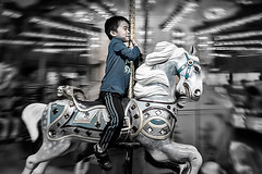 The joy is in the journey, not the destination (Repp1) Tags: boy canada child bc roundabout carousel motionblur burnaby merrygoround enfant carrousel garon burnabyvillagemuseum floudemouvement petitgars