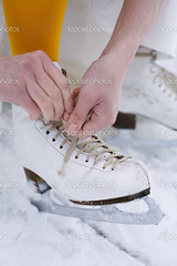 Skates (CaulfieldintheRye1951) Tags: winter woman white snow cold feet ice stockings leather sport yellow closeup female season person foot frozen hands steel iceskating skating style equipment skate recreation blade date skates laces tying wintry fireonice sallyisbae