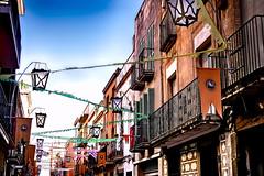 Festes de Sant Joan (Fnikos) Tags: street door sky building window outdoor streetlamp balcony celebration lamppost buildingcomplex