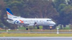 Regional Express Saab 340 VH-REX arrives on a wet Rwy 34 (Graham Mahoney) Tags: canon is 300mm ii 2x tullamarine 1dmarkiv efiii