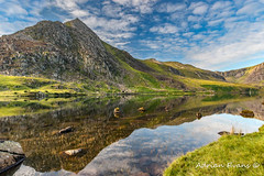 Mountain Reflections (Adrian Evans Photography) Tags: uk summer sky mountain lake mountains water stone wales clouds reflections landscape nikon outdoor landmark british 20mm snowdonia hdr romanroad d800 tryfan northwales ogwen cwmidwal idwal carneddau penyrolewen snowdonianationalpark glyderau llynogwen ogwenvalley adrianevans ogwenlake