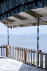 Frill (-j-o-s-e-) Tags: blue sea house abandoned beach water warm day bright balcony ruin sunny grand abandon shade drape caribbean cayman wreck reef frill differentialfocus