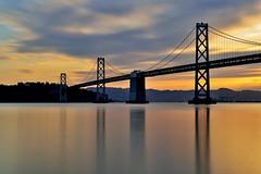 Sunrise Over The Bay Bridge (Rebecca Ang (AWAY)) Tags: sf sanfrancisco california ca longexposure morning bridge light usa water sunrise dawn baybridge embarcadero sanfranciscooaklandbaybridge rebeccaang