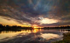 Sunburst..... (Kevin Povenz) Tags: 2016 june kevinpovenz ottawa ottawacounty westmichigan michigan jenison sunset sunburst pond lake reflection canon7dmarkii sigma1020 longexposure clouds sun evening park
