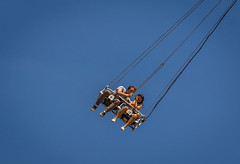 A couple swinging in a ride - Howell, MI ! (vvivek4ever) Tags: carnival couple michigan swing howell balloonfest