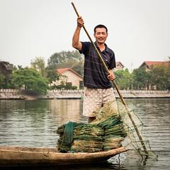 Smiling Fisherman (languitar) Tags: fishing river water smile net tamcoc boat vietnam fisherman rowboat socialistrepublicofvietnam vitnam ninhbnh vn