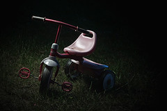 Day 005: Spotlight (agbrickey) Tags: pink black girl grass bike kids digital canon dark toy eos outdoor tricycle flash 7d strobe