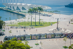 Rio de Janeiro, Brasil - March 06, 2016:  Sign Letters Olympic City in front of the Museu do Amanhã and  VLT Carioca - Light vehicle on rails, stands in Maua Plaza in the regenerated Porto Maravilha area. (Luz Rosa Photography) Tags: 2016 brazil concept rio riodejaneiro transportation vlt2 architecture bay bridge building byland carioca cidadeolimpica city construction de dock fromabove games horizontal janeiro mauaplaza museudoamanha museum museumoftomorrow olympiccity olympicgames olympics outdoors photo photograph photography plaza port pracamaua rio2016 sea sightseeing sign site squaremaua tomorrow tourism tram