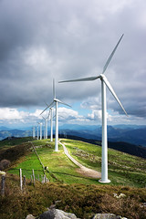 windmill farm in mountain with beautiful light (Mikel Martnez de Osaba) Tags: park blue light sky cloud white mountain green mill industry nature ecology windmill beautiful field electric landscape wings energy technology power wind farm environmental generator electricity environment rotation watts generation turbine alternative sustainable global sustainability renewable rotate generate