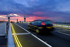 (Claire Hutton) Tags: road uk longexposure bridge pink blue sunset motion blur colour car yellow lights movement twilight traffic working dorset handheld bluehour poole doubleyellowlines notbroken twinsailsbridge fujix20