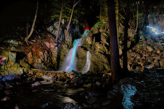 Battle of the Wizards (SunnyDazzled) Tags: longexposure newyork men night forest landscape lights waterfall sticks colorful stream neon glow wizard photographers falls fantasy monroe orangecounty fitzgerald blend takenin3layers