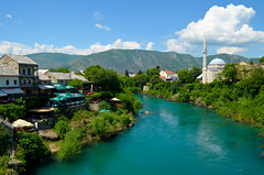 Mostar, Bosnia and Herzegovina (Explored) (Butch Osborne) Tags: river landscape cafe interesting war cityscape mostar bosnia awesome muslim mosque historic explore genocide yugoslavia bosniaandherzegovina explored madeexplore