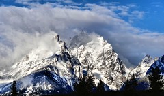 In The Clouds (Dan9900) Tags: blue winter mountain mountains cold west nature beautiful beauty clouds landscape spring cloudy hiking mountainclimbing wyoming tetons grandtetonnationalpark vision:mountain=092