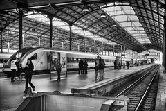 Bahnhof Luzern (mhoffman1) Tags: railroad blackandwhite bw monochrome train switzerland platform rail bahnhof lucerne hdr concourse trainshed photomatix bahnhofluzern silverefexpro