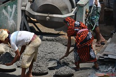 Construction Site (Kaniz Khan 2009) Tags: men stone site workers construction women basket cement labour mixing activity spade labourers