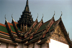 19-572 (ndpa / s. lundeen, archivist) Tags: roof decorations color building tower film rooftop architecture 35mm thailand bangkok nick spire tiles grandpalace thai 1970s ornate gilded 1972 19 1973 eaves gilding dewolf finials nickdewolf coloredtiles photographbynickdewolf reel19