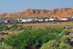 Sunrise Bluffs (AntyDiluvian) Tags: coyote houses newmexico fence desert motel bestwestern rv neighbors rattlesnake belen pests rvs recv