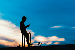 A man on the top (Phn Chua) Tags: blue sunset shadow sky people man black art clouds daylight day alone phone shade lonely snor peo