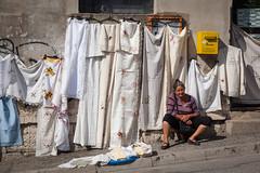 Gypsy (lorenzolozigano) Tags: street travel woman white mostar bosnia blanket herzegovina sheet peddler gypsy reportage gipsy lozigano