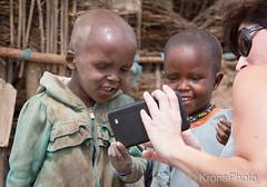 Curious kids (KronaPhoto) Tags: safari kids barn young tanzania africa ngorongoro masai poor fattige help mennesker mobile picture image mirror curious nysgjerrige kontrast contrast girl boy charming adorabel cute beautiful street gatefoto