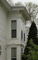 House  Hillsdale, Michigan (Pythaglio) Tags: county wood trees windows house spring michigan incised caps 11 historic frame siding residence trim twostory bushes brackets hillsdale cornice dwelling italianate pedimented