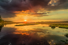 The storm is over now 2 (piotrekfil) Tags: sunset sky sun sunlight storm nature water clouds wow reflections river landscape pentax poland waterscape piotrfil