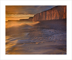 Sunset over the Sisters (Nigel Morton) Tags: ocean sunset sea people beach clouds landscape golden sand waves dusk cliffs sevensisters eastsussex crashing birlinggap goldenhours pebbes nigelmorton