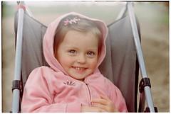 Migl (batuda) Tags: pink portrait color film girl smile spring dof kodak bokeh depthoffield zenit cart c41 zenite helios442 colorplus200 migl fotopro varluva