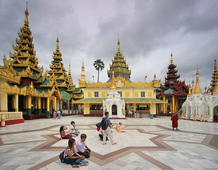 Pilgrims sitting down in front of the Great Dagon Pagoda