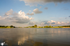 Reflection of the clouds (Robert Stienstra Photography) Tags: water netherlands river landscape outdoors landscapes nikon outdoor wageningen rhine dutchlandscape waterscape naturalforces waterscapes riverrhine landscapephotography riverscape d7100 nikond7100 nikonnl