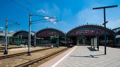 Wrocaw Gwny (PiotrTrojanowski) Tags: blue sky station hall platform tracks poland railway wroclaw breslau