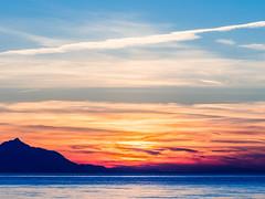 A Dramatic Lemnos Sunset (Mount Athos - View from Blue Waves Cafe-Bar - Myrina ) Olympus OMD EM5II & mZuiko 40-150mm f2.8 Pro Zoom (1 of 1) (markdbaynham) Tags: sunset colour clouds island greek view zoom hellas evil olympus mount greece grecia pro gr zuiko omd athos csc oly mz limnos hellenic m43 zd mft lemnos myrina em5 mirrorless micro43 microfourthird micro43rd mzuiko m43rd em5ii zuikolic