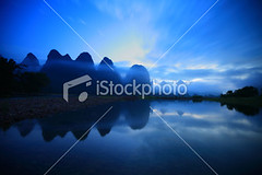 Li river at dusk (MPBHAIBO) Tags: china blue cloud mist mountain reflection water fog stone night sunrise river landscape dawn liriver asia dusk guilin yangshuo hill lantern cloudscape stormcloud cumulonimbus xingping ruralscene karstformation woodenraft guangxiregion